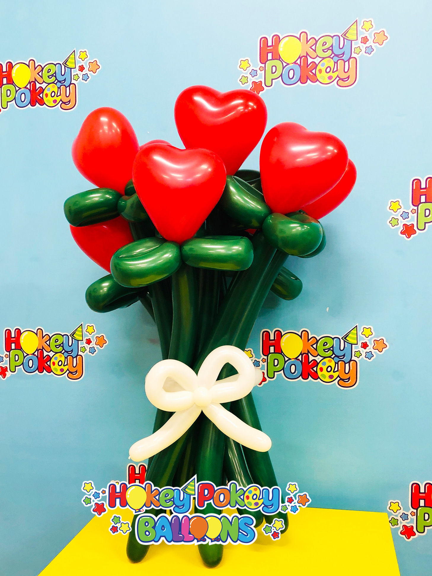 Picture of Heart Flower Balloon Bouquet with Bow (up to 21 flowers)